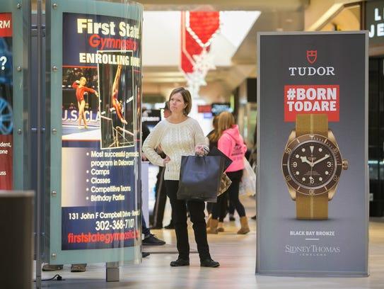 Shoppers hit Black Friday shopping at Christiana Mall.