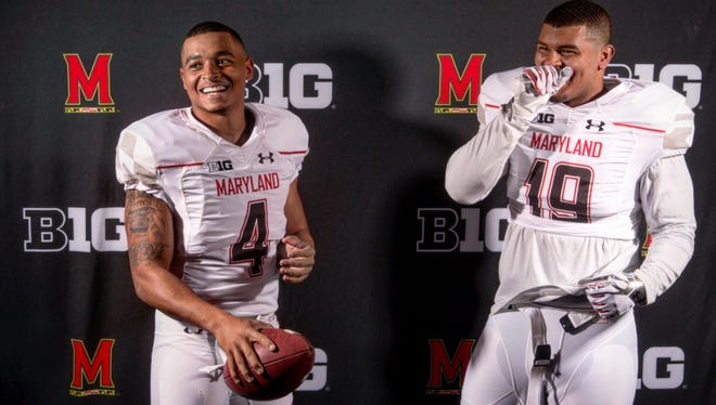 Brothers Ryan Brand, left, and Bryce Brand, right, will be back in Lansing this weekend as Maryland's football team plays at Michigan State.
