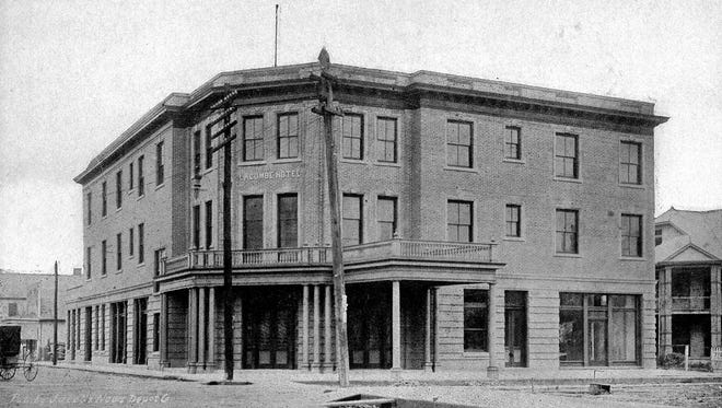 The new Lacombe Hotel on the corner with the Association of Commerce office shown to the right.