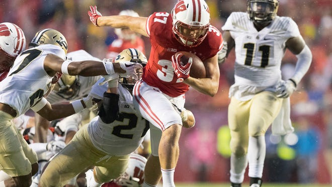 Badgers running back Garrett Groshek had runs of 18 and 14 yards late in the game against Purdue.