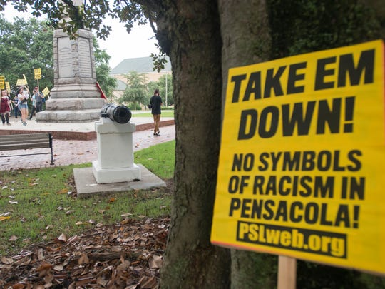 "A group from the Party for Socialism and Liberation holds a ""Take'em Down"" rally to end institutionalized racism and to remove the confederate statue in Lee Square in downtown Pensacola on June 15, 2018."