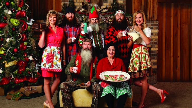 """The """"Duck Dynasty"""" cast (Standing L to R:  Missy Robertson, Jase Robertson, Si Robertson, Willie Robertson, Korie Robertson; seated L to R: Phil Robertson, Miss Kay Robertson) has 2013's top-selling new Christmas album, """"Duck the Halls: A Robertson Family Christmas."""""""