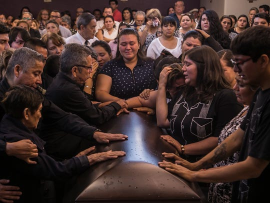 Friends and relatives say their last goodbyes during
