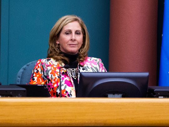 City council member Debbie Lindsey-Opel listens as