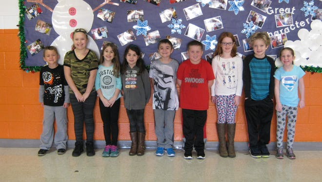 Second-graders named Students of the Month for December at Janvier School are (from left): Cameron Frye, Riley Hunter, Sophia Sottile, Neko Faust, Logan Kinsella, Thomas Kinsley, Katie Auge, Lucas Hampton and Sophia Cartwright.