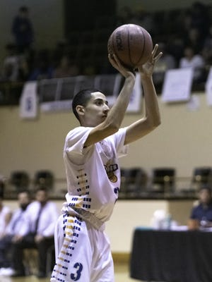 Dolores Huerta Preparatory High School's Gabe Ruybal shoots a 3-pointer during the Scorpions matchup with Peyton in late February in Colorado Springs.