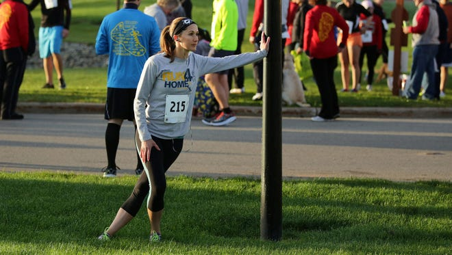 Sarah-Beth Janssen of Neenah stretches before the 22nd Annual St. Joe's 5K Run/Walk takes place Oct. 10 around Bridgewood Resort Hotel and Conference Center in Neenah.