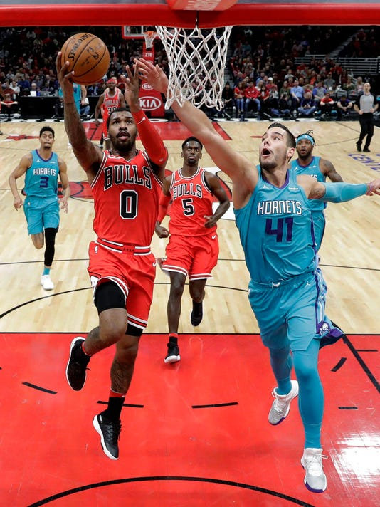 Chicago Bulls' Sean Kilpatrick (0) scores past Charlotte Hornets' Willy Hernangomez (41) during the first half of an NBA basketball game Tuesday, April 3, 2018, in Chicago. The Bulls won 120-114. (AP Photo/Charles Rex Arbogast)