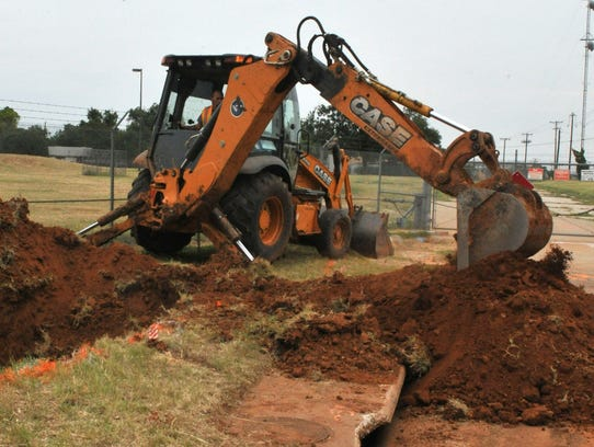 Heavy machinery was used to help un-earth a portion