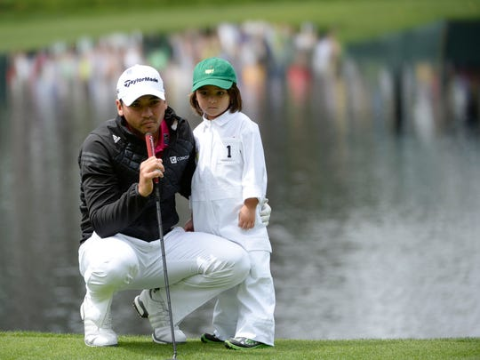 Jason Day with son Dash Day on the 4th green during
