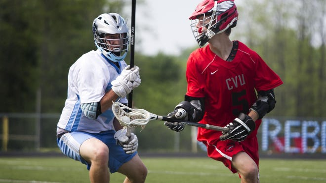 CVU attackman Sam Sturim changes direction with the ball during a high school boys lacrosse game at South Burlington on Saturday morning. CVU won 10-6.