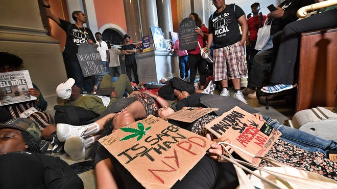 Protesters urging legislators to pass Marijuana legislation lay on the floor outside the Assembly Chamber doors June 19 at the state Capitol in Albany.