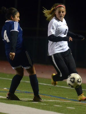 Lindsay Rector of West Milford, right. dribbles past a defender in a 2016 contest.