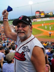 Sounds fan Tony Slayden cheers for his team during the last game at Greer Stadium in 2014.