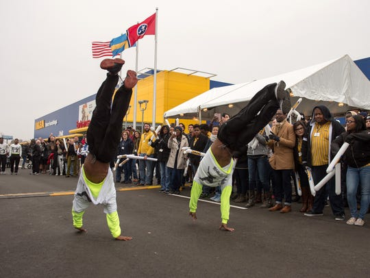 Performers with the Beale Street Flippers provide entertainment during an event marking the grand opening of the Ikea Memphis store in December 2016.