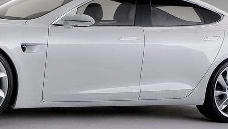 The high-tech door handles on a Model S remain flush with the body until it detects a driver approaching