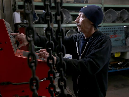 Phil Rock, a transmission technician, at Milt & Ron's Transmission, works to test a pressure solenoid off a transmission.