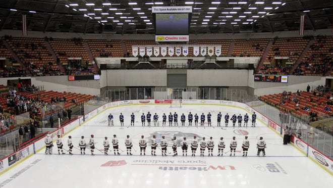 The Waukesha Wings Co-op hockey team lines up for player introductions at the beginning of the quarterfinals of the WIAA state hockey championships in Madison Thursday, March 3, 2016. This was the teams first appearance at the state championships in the history of the team.