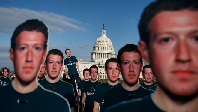 Cutouts of Facebook CEO Mark Zuckerberg at the Capitol on April 10, 2018.