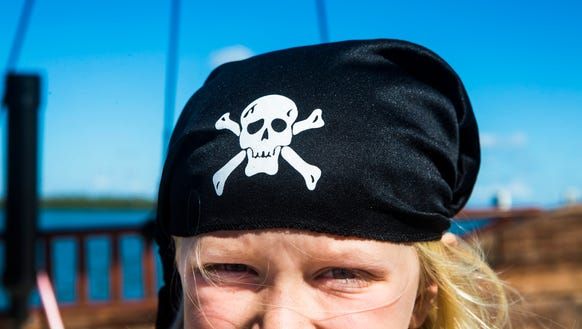Macey Johnson, 7, poses for a portrait in her pirate