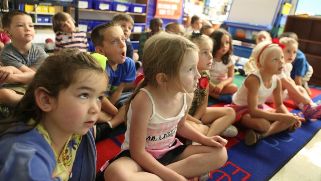 Kindergartners recite a poem during the first day of school, Sept. 3, at Putnam Valley Elementary School.
