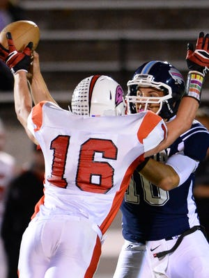 Jack Beattie of Bozeman, the top-ranked team in the Tribune's Top 25 AA poll, puts heat on the quarterback earlier this fall at Memorial Stadium in Great Falls.