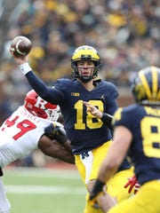 Michigan's Brandon Peters passes against Rutgers in