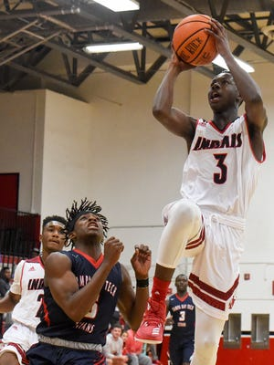 Vero Beach's Tommie Lewis (3) shoots over Tampa Bay Tech's David Cexil (5) Saturday, Dec. 30, 2017, during their high school boys basketball championship game at the Holiday Hoopla Tournament at Vero Beach High School. To see more photos, TCPalm.com.