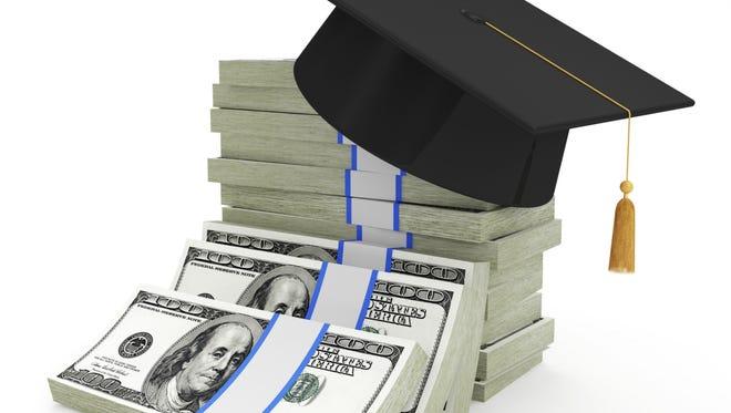Graduation Cap on Stack of Dollar Bills