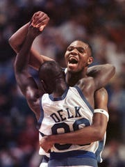 Kentucky's Walter McCarty and Tony Delk (00) celebrate Kentucky's 83-63 win over Wake Forest in the NCAA Midwest Regional final in Minneapolis on Saturday, March 23, 1996.