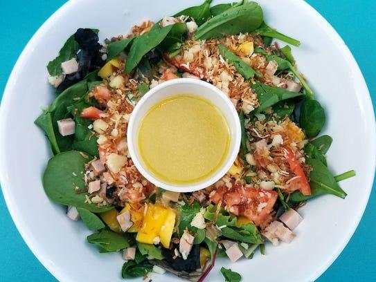 Sneaki Tiki's Island Salad was mixed greens topped