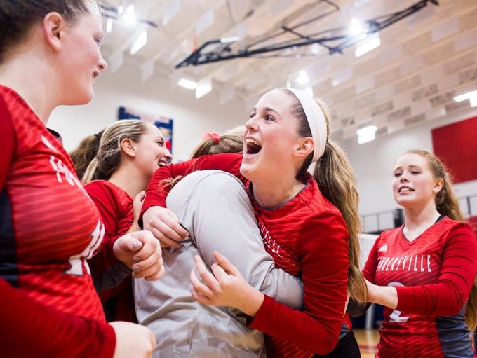 Powderville's Alexis Albright celebrates with her teammates