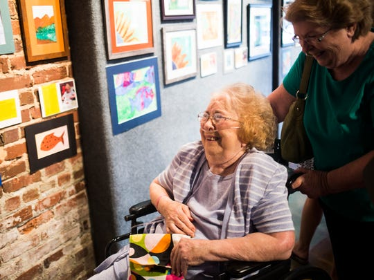 Marion Turner (left) and her sister Judy Wetterman (right) delight in seeing Turner's artwork on display at an art exhibit of original watercolors created by local senior citizens through a program called Senior Studio on Tuesday, September 27, 2016 at the Anderson Arts Center.