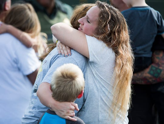 Parent Korrie Bennett hugs Heather Bailey after recovering