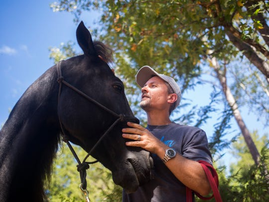 Greg Grochowski of Ravenel works with his horse, Brego, on a local farm on Thursday, October 6, 2016 in Anderson. Grochowski and his family had to evacuate their home due to Hurricane Matthew.