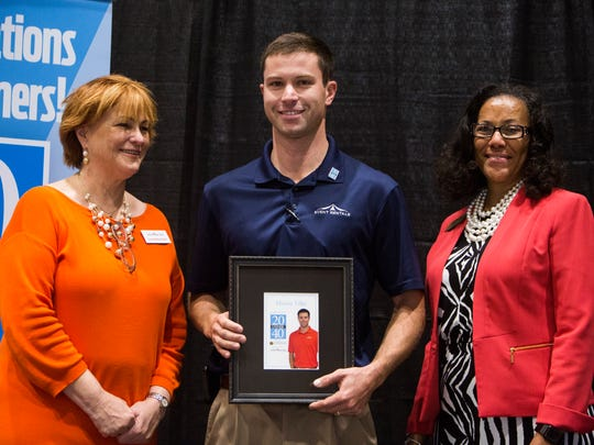Martin Tiller is presented with his awards at the 20 Under 40 luncheon at the Civic Center of Anderson on Tuesday, October 18, 2016 in Anderson.