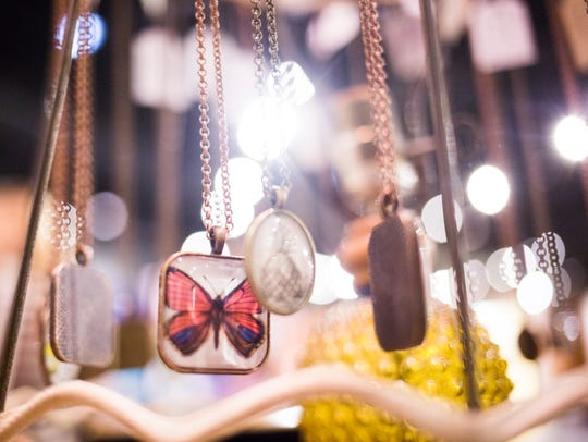 Unique vintage style necklaces are displayed during