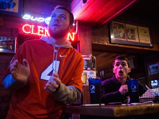Clemson fans Craig Lucas and Grayson Love watch Clemson take on Virginia Tech at The Esso Club on Saturday, December 3, 2016 in Clemson.