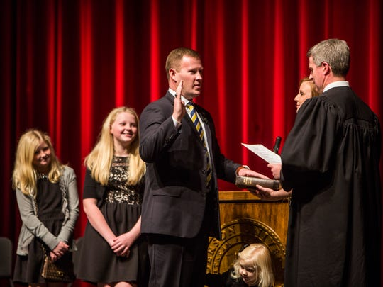 Chad McBride takes the oath of office as sheriff of Anderson County on Thursday on the Anderson University campus.