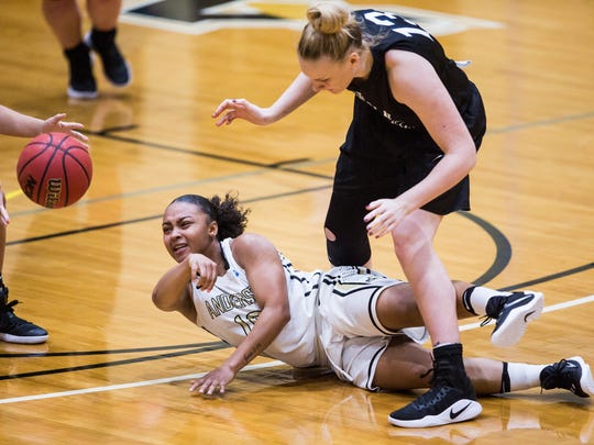 Anderson University's Tamia Eatmon passes the ball Wednesday after gaining possession in a game in Anderson against Lincoln Memorial.