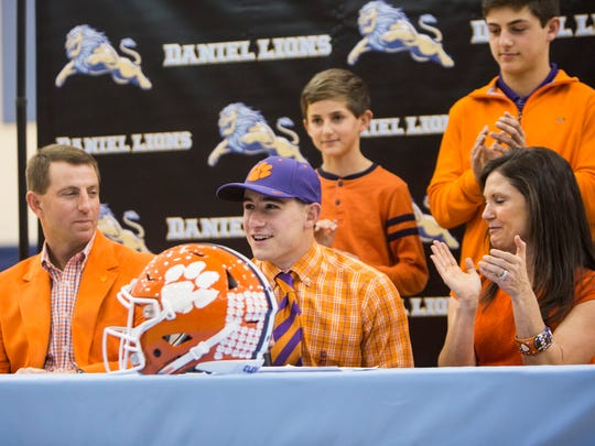 Surrounded by his family, wide receiver Will Swinney signs with Clemson as a preferred walk-on on National Signing Day at D.W. Daniel High School on Wednesday, February 1, 2017 in Central.