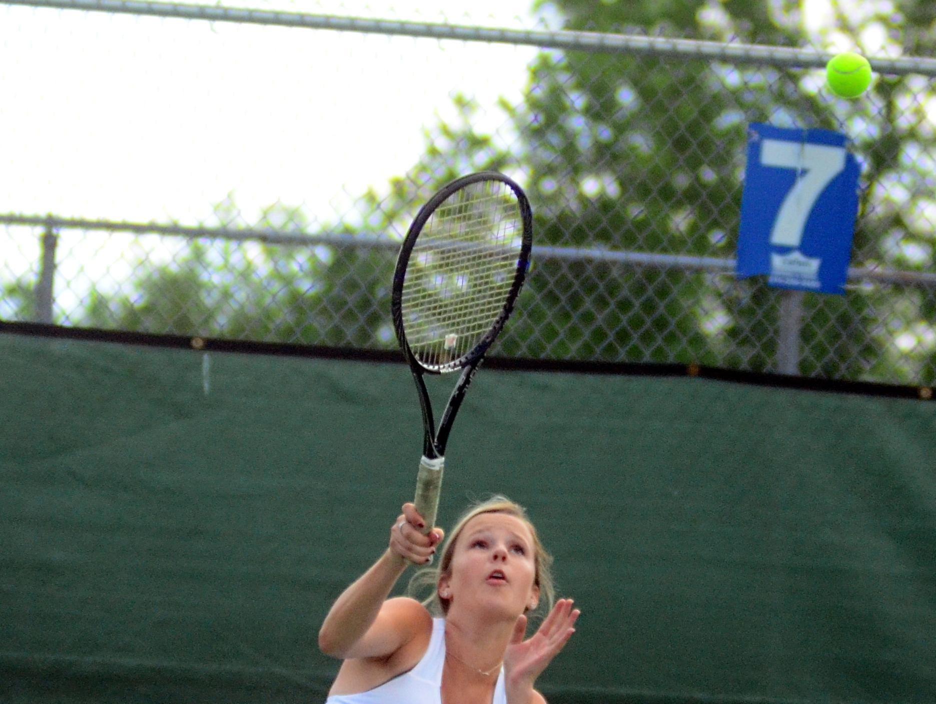 Hendersonville High sophomore Caroline Miller serves during Wednesday's doubles semifinals.