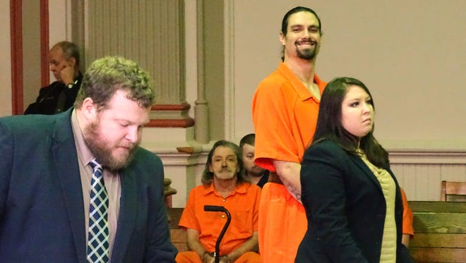 Accompanied with attorney Jessica Wirick, Nicholas Hale smiles for a picture on Monday in Muskingum County Common Pleas Court. Hale was recently found competent to stand trial. He's suspected in an October standoff with police during which hostages were taken.