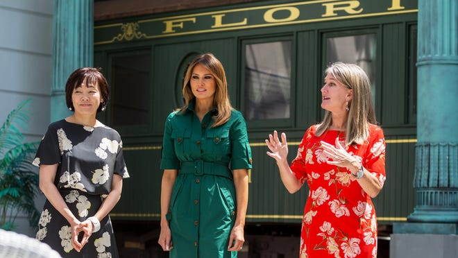 Flagler Museum Executive Director Erin Manning, (R) gives a tour of the Pavillon to first ladies Melania Trump, (C) and Akie Abe  of Japan, during a tour in Palm Beach.