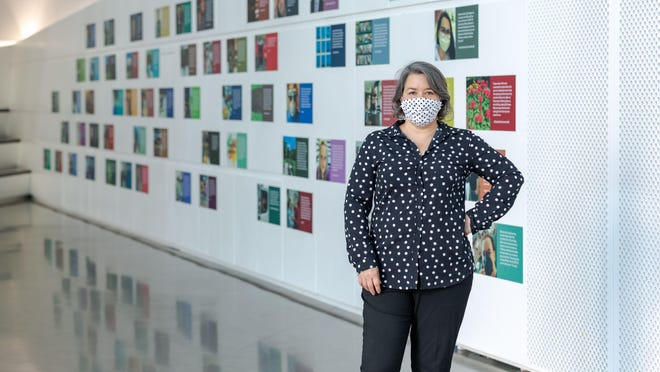 Monica Ramirez -Montagut, the new Executive Director of the Eli and Edythe Broad Art Museum at Michigan State University, in front of the Acts of Care exhibit.