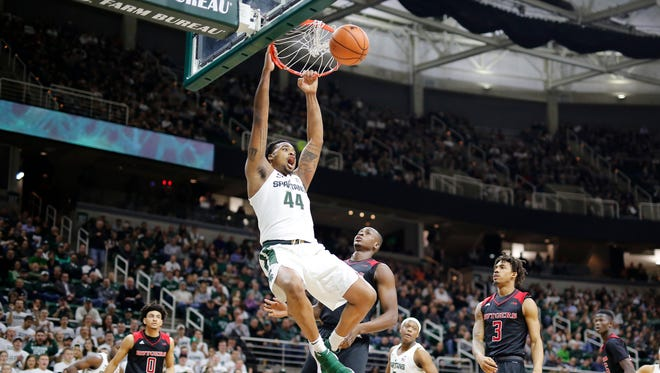 .Nick Ward #44 of the Michigan State Spartans dunks the ball during a game against the Rutgers Scarlet Knights at Breslin Center on January 10, 2018 in East Lansing, Michigan..