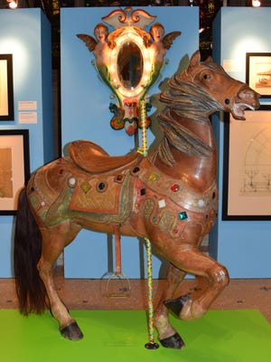 This  Sept. 8, 2014 photo provided by the Green-Wood Historic Fund shows a wooden horse from an amusment park carousel built by William Mangels in an exhibit of his creations at the the Green-Wood Cemetery, where he is buried, in the Brooklyn borough of New York. Mangels, who was passionate about amusement parks, built carousels, shooting ranges and other rides for Coney Island and other parks during the first quarter of the 20th century. (AP Photo/Green-Wood Historic Fund, Art Presson)