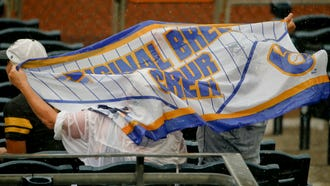Brewers fans watched the end of the team's dismal road trip in the pouring rain in PIttsburgh on Sunday.
