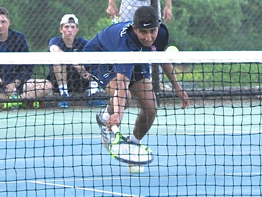 Byram Hills' Arjun Goyal goes low to return a shot