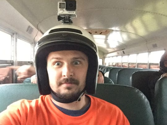 The moment Battle Creek Enquirer reporter Nick Buckley realized what he signed up for during the figure-eight bus race at Galesburg Speedway on June 3, 2018.